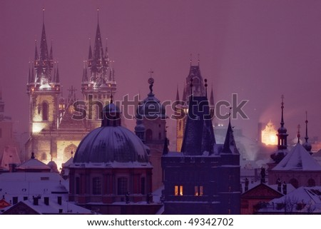 prague - spires of the old town during heavy snowfall