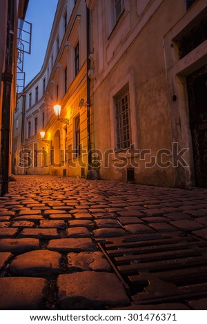 Prague street at night with sewer - stock photo