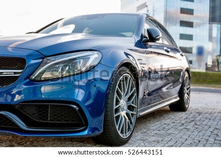 PRAGUE, THE CZECH REP., NOVEMBER 27, 2016: Closeup of new luxury car Mercedes-Benz c-class C63, parking in front of car store. Detail front view of cars