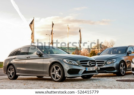 PRAGUE, THE CZECH REP., NOVEMBER 27, 2016: Closeup of new luxury cars Mercedes-Benz c and e class parking in front of car store. Detail front view of cars