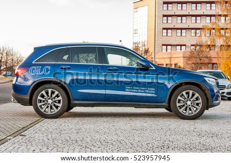 PRAGUE, THE CZECH REP., NOVEMBER 27, 2016: Profile view of luxury car Mercedes-Benz GLC 220d parking in front of car store Daimler.