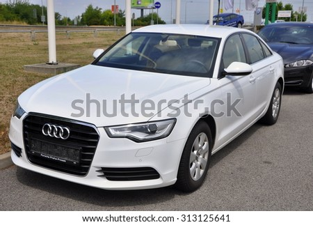 PRAGUE, THE CZECH REPUBLIC, 02.08.2015 - Brand new white Audi A6 parks in front of Car Store Audi - stock photo