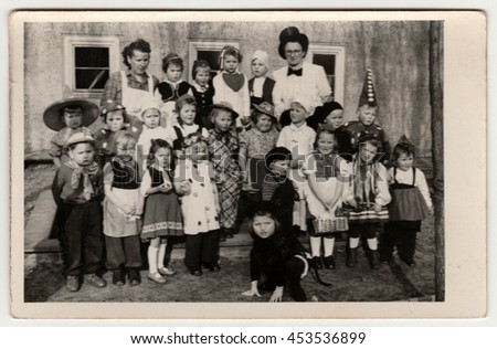PRAGUE, THE CZECHOSLOVAK REPUBLIC - CIRCA 1950s: Vintage photo shows children/pupils wear funny costumes. Children pose after theatre performance. Black & white photography