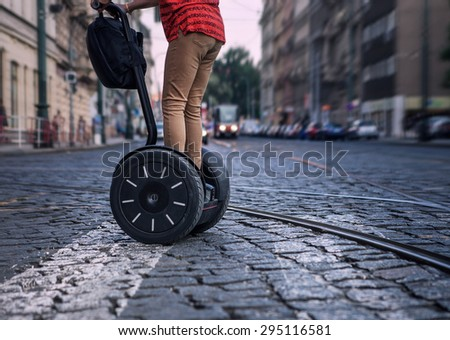 Prague tourist on electric scooter - stock photo