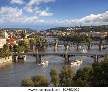 Prague - view with Vltava River, Charles Bridge and bridges - stock photo