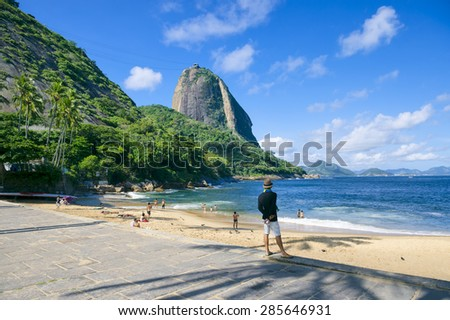 Praia Vermelha Red Beach quiet afternoon with view of Sugarloaf Mountain and palm tree shadows Rio de Janeiro Brazil - stock photo