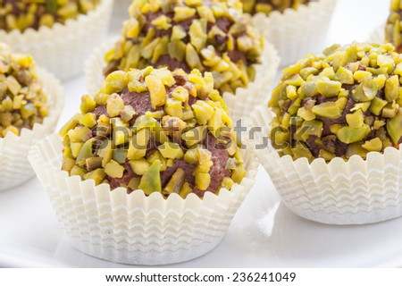 praline chocolate with chopped pistachios - stock photo
