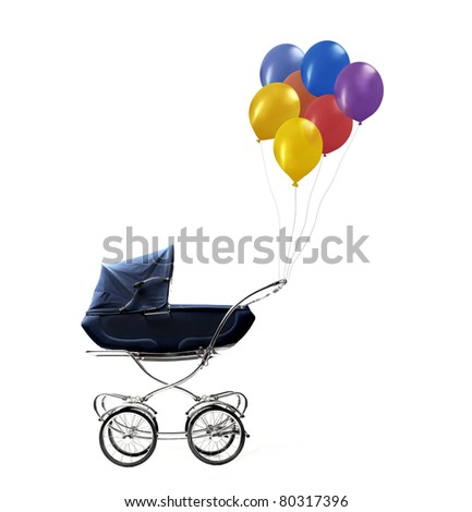 Pram with balloons hanging on its handle - stock photo