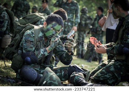 "PRANBURI, PRACHUAP KHIRI KHAN , THAILAND - NOV 24, 2014: Unidentified soldier  alert and arm for maneuver in  ""The Ultimate Soldier"" 72 hours battle operation of Thai Royal Army, THAILAND. - stock photo"