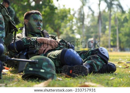 "PRANBURI, PRACHUAP KHIRI KHAN , THAILAND - NOV 24, 2014: Unidentified soldier arm and waiting for maneuver in  ""The Ultimate Soldier"" 72 hours battle operation of Thai Royal Army, THAILAND. - stock photo"