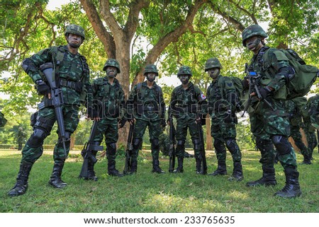 "PRANBURI, PRACHUAPKHIRIKHAN, THAILAND - NOV 24, 2014: Unidentified soldier team standing and wait for maneuver in ""The Ultimate Soldier"" 72 hours battle operation of Thai Royal Army, THAILAND. - stock photo"