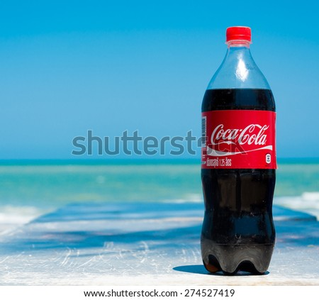 Pranburi,Thailand. March 31,2015.Coca cola bottle with sea background. Coca-Cola is a carbonated soft drink sold in stores, restaurants - stock photo