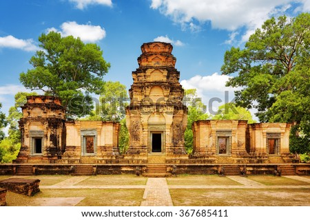 Prasat Kravan temple is Khmer monument in ancient temple complex Angkor Wat, Siem Reap, Cambodia. Woods and blue sky in background. Angkor Wat is a popular tourist attraction. - stock photo