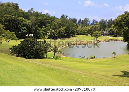Praslin Island, Seychelles - March 10, 2015: Lake on golf course at the Constance Lemuria Resort.
