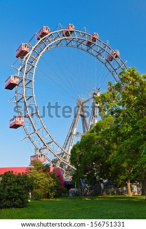 Prater - a historic ferris wheel with red cabins in Vienna, Austria - stock photo