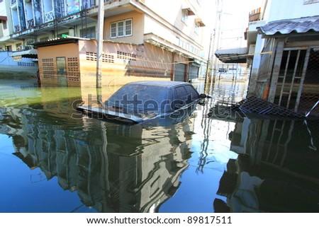 PRATHUMTHANI, THAILAND - NOV 28 : flooded street after flood disaster in Nava nakorn, Prathumthani, Thailand on November 28, 2011. - stock photo