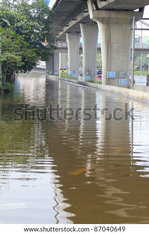 PRATHUMTHANI, THAILAND - OCTOBER 19: Heavy flooding from monsoon rain in Ayutthaya and north Thailand arriving in Bangkok suburbs on October 19, 2011 in Prathumthani, Thailand. - stock photo