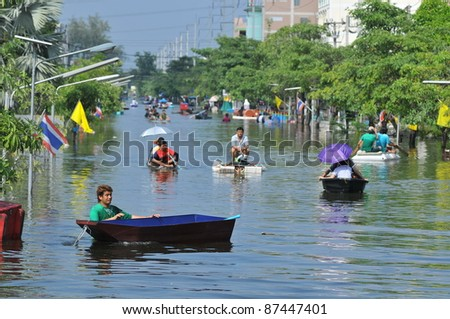 PRATHUMTHANI, THAILAND - OCTOBER 22: Heavy flooding from monsoon rain in Ayutthaya and north Thailand arriving in Bangkok suburbs on October 22, 2011 in Prathumthani, Thailand. - stock photo