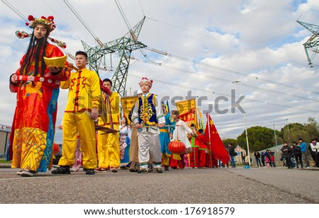 PRATO, ITALY - FEBRUARY 14: Children in traditional costume during the Chinese New Year celebrations, on February 15, 2014 in Prato (Italy)
