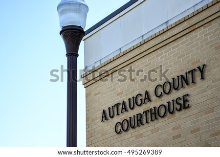 Prattville, Alabama, USA - October 8, 2016: View of the outside corner of the Autauga County Courthouse with lettering on the wall