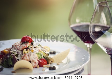 Prawn salad in a restaurant, with wine