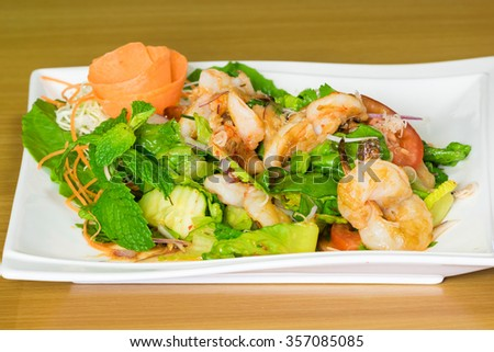 Prawn salad. Simple and healthy salad of shrimp, mixed greens an - stock photo