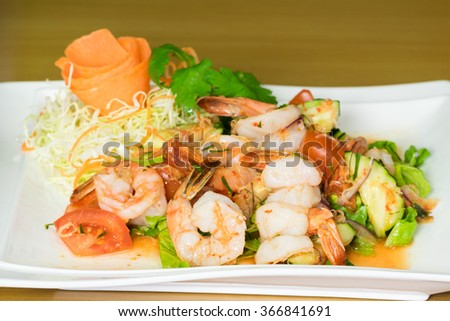 Prawn salad. Simple and healthy salad of shrimp, mixed greens and spicy sauce - stock photo