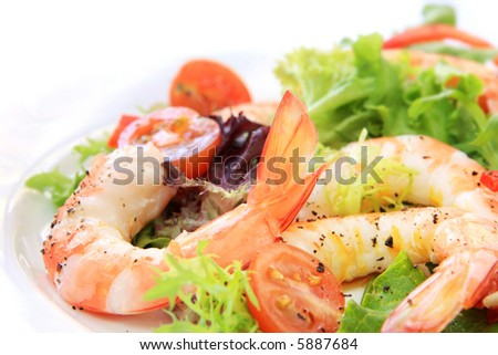 Prawn salad.  Simple and healthy salad of shrimp, mixed greens and tomatoes. - stock photo