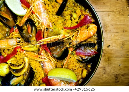 Prawn with rice - closeup of prawn with rice - traditionnal spanish food paella - stock photo