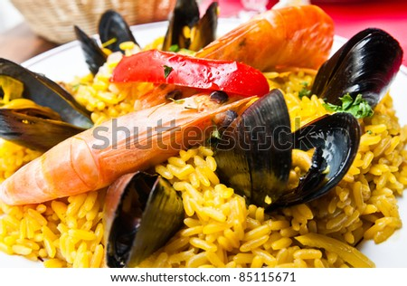 Prawn with rice - closeup of prawn with rice - traditionnal spanish food paella - stock photo