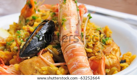 prawn with rice - traditionnal spanish food paella - stock photo