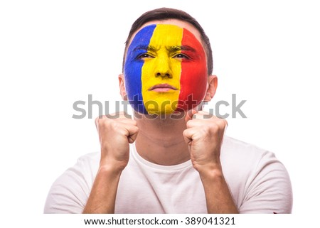 Pray and wish for win Romanian football fan in game  of Romania national team on white background. European football fans concept.