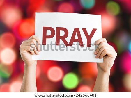 Pray card with colorful background with defocused lights - stock photo