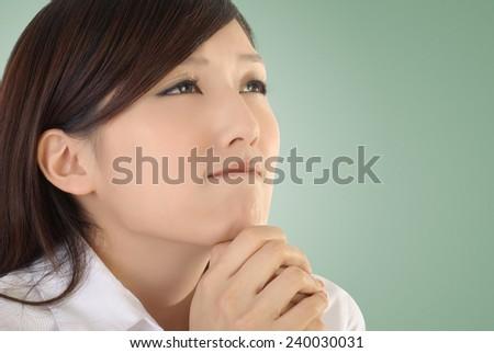 Pray concept of Asian business woman portrait. - stock photo