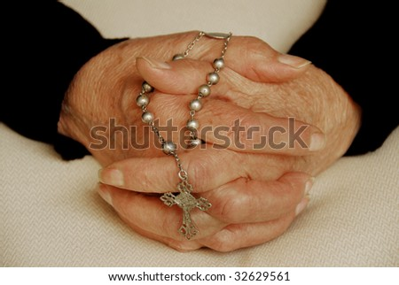 Pray. Old hands with rosary - stock photo