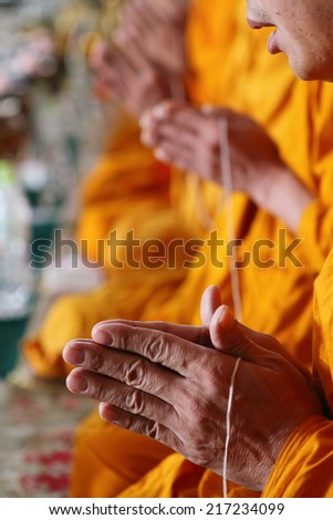 pray, the monks and religious rituals in thai Buddhist ceremony. - stock photo