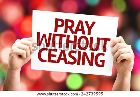 Pray Without Ceasing card with colorful background with defocused lights - stock photo