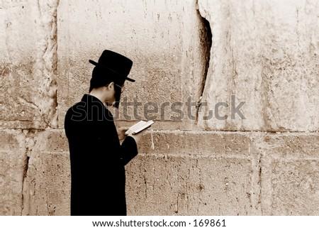 Prayer at the Western Wall, Jerusalem - stock photo
