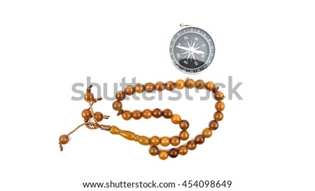 Prayer beads with compass on white background