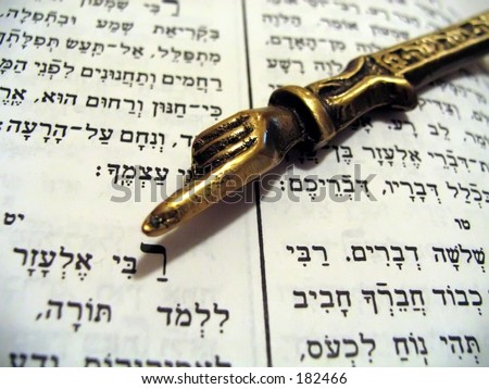 prayer book with finger stick - stock photo