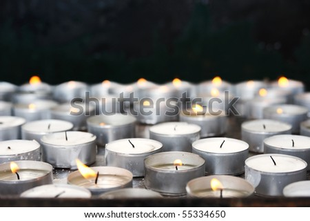 Prayer candles in church - close up - stock photo