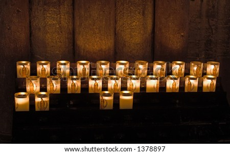 Prayer candles in Notre Dame cathedral, Paris, France