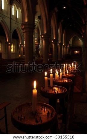 Prayer candles in the isle to the south side of the nave in Christchurch Anglican Cathedral, Canterbury New Zealand - stock photo