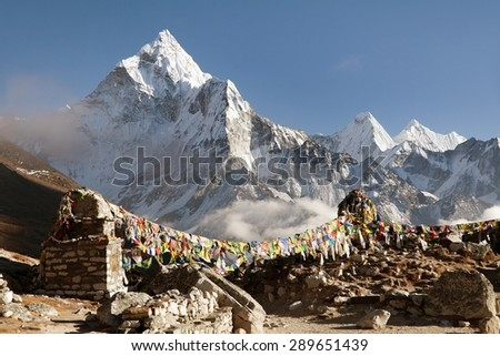 Prayer flags and mount Ama Dablam, beautiful view from Khumbu valley, Solukhumbu, way to Everest base camp - Sagarmatha national park - Nepal - stock photo