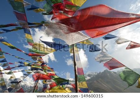 Prayer flags in Langtang, Nepal. - stock photo