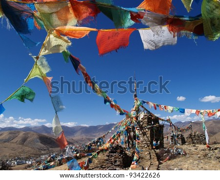 Prayer flags in Tibet with mountain background - stock photo