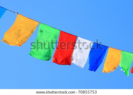 prayer flags on blue sky background