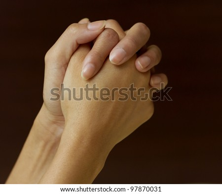 prayer hand waiting for an answer - stock photo