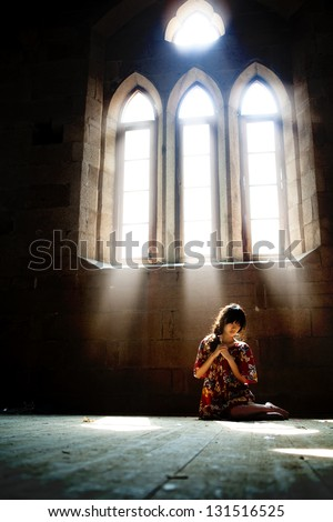 Prayer in church - stock photo