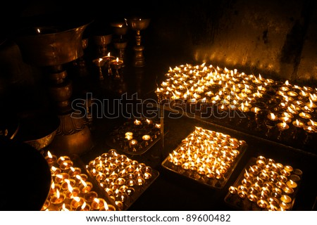 Prayer lamps in a Buddhist monastery - stock photo